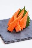 Cut Kani Crab Stick Sashimi Served with Sliced Radish on Stone Plate Royalty Free Stock Photos