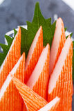 Cut Kani Crab Stick Sashimi Served with Sliced Radish on Stone Plate Royalty Free Stock Image