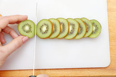 Cut kiwi exposed on the board stock images