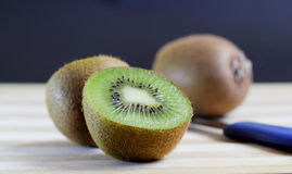 Cut Kiwi. Freshly cut kiwi on a chopping board Stock Photo