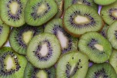 The cut kiwi fruit. Close-up background texture stock image