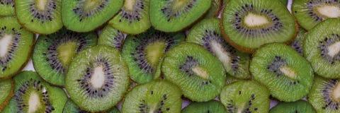 The cut kiwi fruit. Close-up background texture stock photo