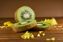 Cut kiwi fruit on wooden table Royalty Free Stock Photos
