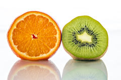 Cut kiwi and orange Royalty Free Stock Photos