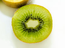 Cut kiwi with seeds stock photos