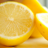 Cut lemon closeup Stock Photos