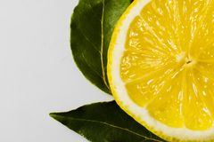 Cut lemon with green leaves Royalty Free Stock Photo