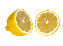 Cut lemon halves isolated over white. Fresh and juicy,sliced lemon royalty free stock photography