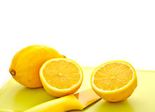 Cut lemon with knife 2 Royalty Free Stock Photography