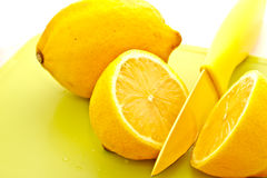 Cut lemon with knife 3 Royalty Free Stock Photography