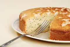 Cut lemon poppy seed cake with a fork Royalty Free Stock Photo