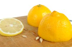 Cut Lemon with Seeds on Wooden Cutting Board Stock Photography