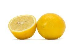 Cut lemons. A lemon and a half on white background. Isolation Stock Photo