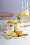 Cut lemons on a cutting board Royalty Free Stock Photos