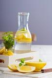 Cut lemons on a cutting board Stock Photos