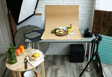 Cut lemons, mint and ginger on table. In professional studio. Food photography royalty free stock photos