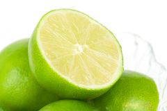 Cut Lime in a Bowl. A cut lime in a clear glass bowl of limes Stock Photography