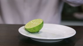 Cut a lime closeup stock video footage