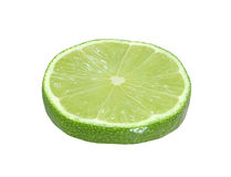Cut lime fruits isolated on white with clipping path Royalty Free Stock Photo