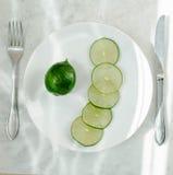 Cut lime on a plate Stock Photos
