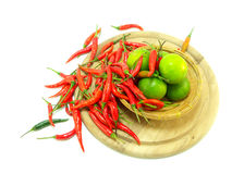 Cut lime and red chilies Royalty Free Stock Images