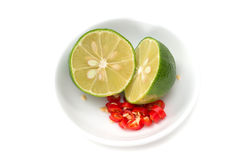 Cut lime and red chillies Stock Images