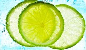 Cut limes Stock Photo