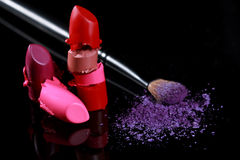 Cut Lipstick Pieces Stacked Together With Eyeshadow Stock Photos