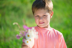 Cut little boy with bunch of flowers Stock Photos