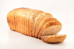 The cut loaf of bread. On white Royalty Free Stock Photography