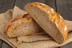 Cut loaf of bread on burlap Stock Image