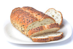 The cut loaf of bread. Royalty Free Stock Image