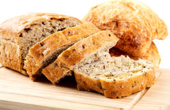 The cut loaf of bread with reflaction isolated Stock Images