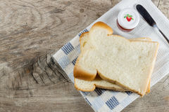 The cut loaf of bread on Tablecloth Royalty Free Stock Image