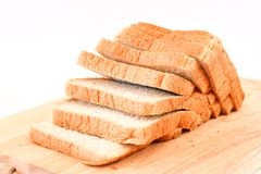 The cut loaf of bread  on white Background. The cut loaf of bread on Wood block  on white Background Royalty Free Stock Image