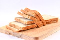 The cut loaf of bread   on white Background. The cut loaf of bread on Wood block  on white Background Royalty Free Stock Photography