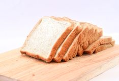 The cut loaf of bread on white Background. The cut loaf of bread on Wood block  on white Background Royalty Free Stock Photo