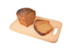 The cut loaf of bread on wooden board Royalty Free Stock Photography