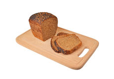 The cut loaf of bread on wooden board Stock Photos