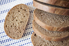 Cut loaf of brown bread Stock Images