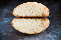 Cut loaf of homemade sourdough bread Royalty Free Stock Photos