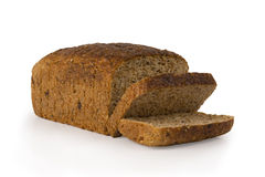 The cut loaf of seed bread on white. Healthy royalty free stock images