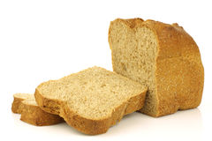 Cut loaf of wholemeal bread and some slices Royalty Free Stock Photography