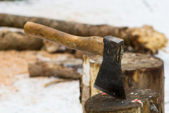 Cut log fire wood and axe Stock Images