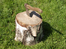 Cut log fire wood and old axe. Stock Images