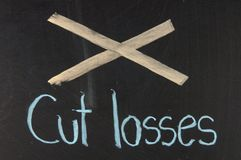 Cut losses Royalty Free Stock Images