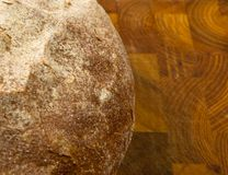 Malt bread handmade. Cut malt bread handmade on wooden background Stock Image