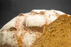 Malt bread handmade. Cut malt bread handmade on wooden background Stock Images