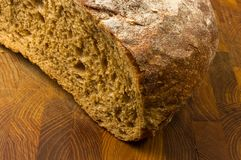 Malt bread handmade. Cut malt bread handmade on wooden background Stock Photography