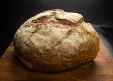 Malt bread handmade. Cut malt bread handmade on wooden background Royalty Free Stock Photography